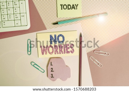 Writing note showing No Worries. Business photo showcasing an expression used to say that everything is all right Writing equipments and computer stuffs placed above colored plain table.