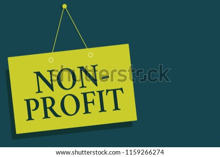 Writing note showing Non Profit. Business photo showcasing providing products or service without paying back in return Yellow board wall communication open close sign gray background.