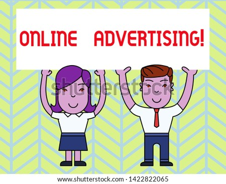 Writing note showing Online Advertising. Business photo showcasing Internet Web Marketing to Promote Products and Services Two Smiling People Holding Poster Board Overhead with Hands.