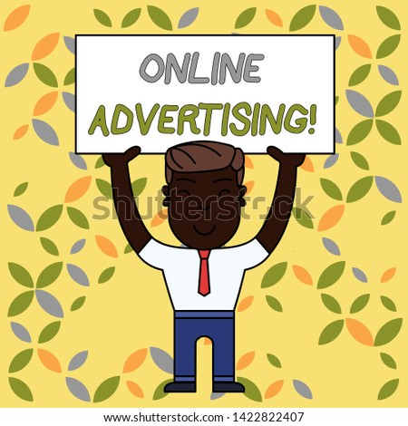 Writing note showing Online Advertising. Business photo showcasing Internet Web Marketing to Promote Products and Services Smiling Man Standing Holding Big Empty Placard Overhead with Both Hands.