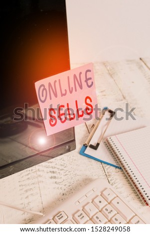 Writing note showing Online Sells. Business photo showcasing sellers directly sell goods or services over the Internet Note paper taped to black computer screen near keyboard and stationary.