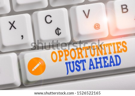 Writing note showing Opportunities Just Ahead. Business photo showcasing Advantageous circumstances Perseverance pays off Keyboard with note paper on white background key copy space.