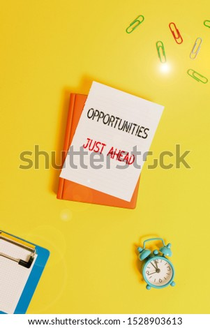 Writing note showing Opportunities Just Ahead. Business photo showcasing Advantageous circumstances Perseverance pays off Paper clips with blank papers for text messages.