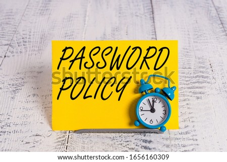 Writing note showing Password Policy. Business photo showcasing first line of protection against any unauthorized access Alarm clock tilted above buffer wire in front of notepaper. Stock fotó ©