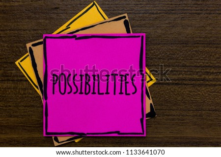 Writing note showing Possibilities. Business photo showcasing Things that may happen or be the case State of being possible Three art small paper two yellow one pink wood brown lite grey shadow. #1133641070
