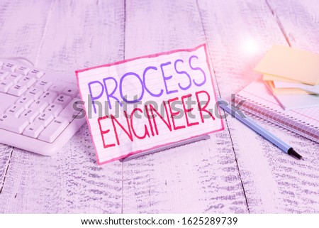 Writing note showing Process Engineer. Business photo showcasing responsible for developing new industrial processes Notepaper on wire in between computer keyboard and sheets.