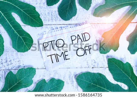 Writing note showing Pto Paid Time Off. Business photo showcasing Employer grants compensation for demonstratingal holidays Leaves surrounding notepaper above a classic wooden table.