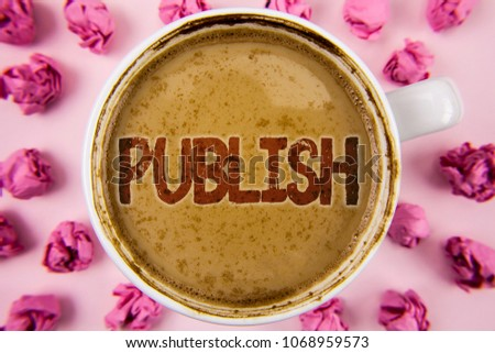 Writing note showing  Publish. Business photo showcasing Make information available to people Issue a written product written on Coffee in White Cup within Paper Balls on plain background. #1068959573