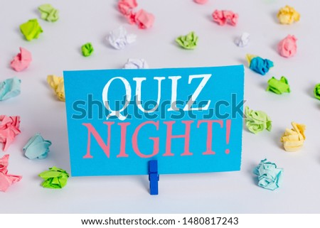 Writing note showing Quiz Night. Business photo showcasing evening test knowledge competition between individuals Colored crumpled paper empty reminder white floor clothespin.