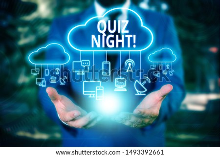 Writing note showing Quiz Night. Business photo showcasing evening test knowledge competition between individuals Male wear formal work suit presenting presentation smart device.