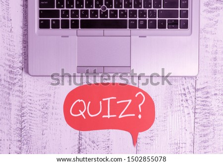 Writing note showing Quiz Question. Business photo showcasing test of knowledge as competition between individuals or teams Close view open laptop speech bubble downwards lying vintage table.