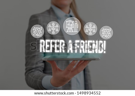 Writing note showing Refer A Friend. Business photo showcasing direct someone to another or send him something like gift Woman wear formal work suit presenting presentation using smart device.