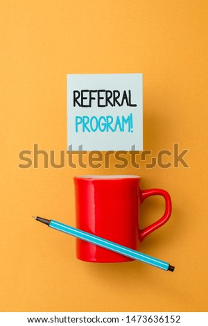 Writing note showing Referral Program. Business photo showcasing internal recruitment method employed by organizations Front view coffee cup colored sticky note pen yolk color background. #1473636152