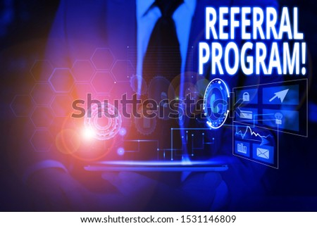 Writing note showing Referral Program. Business photo showcasing internal recruitment method employed by organizations Male wear formal suit presenting presentation smart device. #1531146809