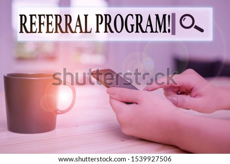 Writing note showing Referral Program. Business photo showcasing internal recruitment method employed by organizations woman using smartphone and technological devices inside the home. #1539927506