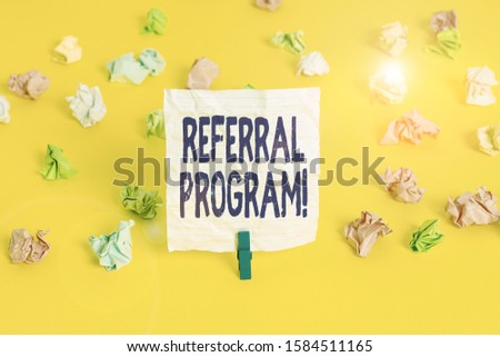 Writing note showing Referral Program. Business photo showcasing internal recruitment method employed by organizations Colored crumpled paper empty reminder white floor clothespin.