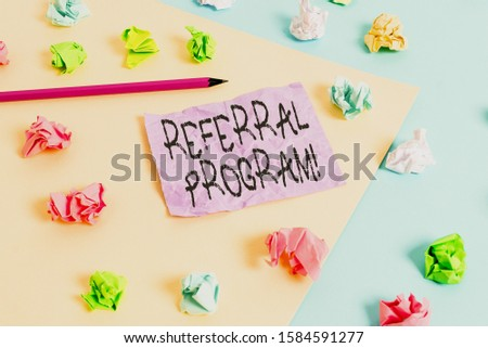 Writing note showing Referral Program. Business photo showcasing internal recruitment method employed by organizations Colored crumpled papers empty reminder blue yellow clothespin.