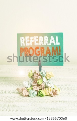 Writing note showing Referral Program. Business photo showcasing internal recruitment method employed by organizations Reminder pile colored crumpled paper clothespin wooden space.