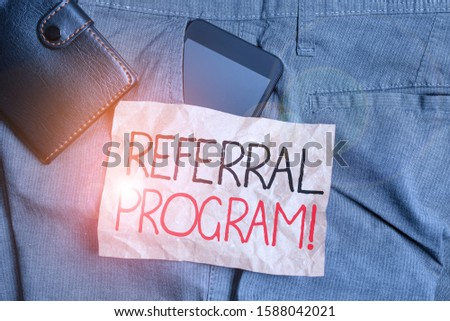 Writing note showing Referral Program. Business photo showcasing internal recruitment method employed by organizations Smartphone device inside trousers front pocket with wallet.