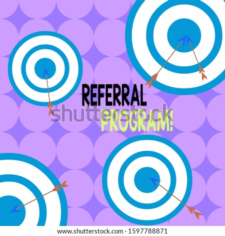Writing note showing Referral Program. Business photo showcasing internal recruitment method employed by organizations Arrow and round target asymmetrical shape multicolour design.