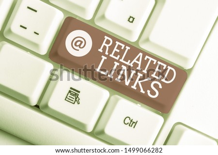 Writing note showing Related Links. Business photo showcasing Website inside a Webpage Cross reference Hotlinks Hyperlinks White pc keyboard with note paper above the white background. Сток-фото ©