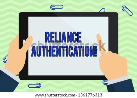 Writing note showing Reliance Authentication. Business photo showcasing part of trust based identity attribution process Hand Holding Pointing Touching Color Tablet White Screen.