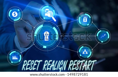 Writing note showing Reset Realign Restart. Business photo showcasing Life audit will help you put things in perspectives Male wear formal suit presenting presentation smart device.