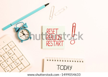 Writing note showing Reset Realign Restart. Business photo showcasing Life audit will help you put things in perspectives Copy space on empty note paper with clock and pencil on the table.