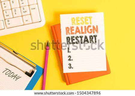 Writing note showing Reset Realign Restart. Business photo showcasing Life audit will help you put things in perspectives Pile of empty papers with copy space on the table. #1504347896