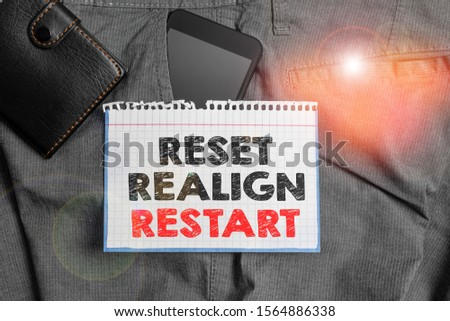 Writing note showing Reset Realign Restart. Business photo showcasing Life audit will help you put things in perspectives Smartphone device inside trousers front pocket with wallet. #1564886338