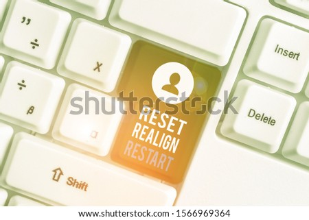 Writing note showing Reset Realign Restart. Business photo showcasing Life audit will help you put things in perspectives White pc keyboard with note paper above the white background. #1566969364