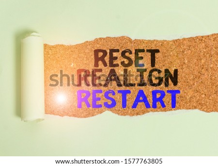 Writing note showing Reset Realign Restart. Business photo showcasing Life audit will help you put things in perspectives Cardboard which is torn placed above a wooden classic table. #1577763805