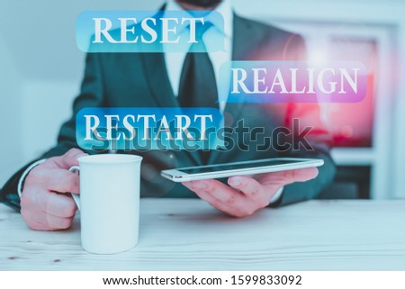 Writing note showing Reset Realign Restart. Business photo showcasing Life audit will help you put things in perspectives Male human wear formal clothes present use hitech smartphone.