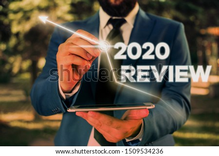 Writing note showing 2020 Review. Business photo showcasing seeing important events or actions that made previous year. #1509534236