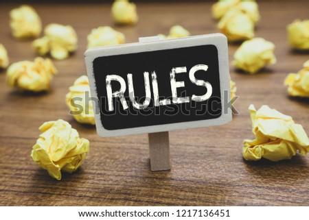 Writing note showing Rules. Business photo showcasing exercise ultimate power authority over area and its people Regulation Blackboard crumpled papers several tries not satisfied wooden floor.