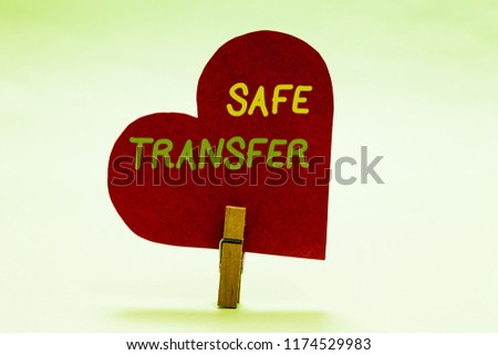 Writing note showing Safe Transfer. Business photo showcasing Wire Transfers electronically Not paper based Transaction Clothespin holding red paper heart important romantic message ideas. #1174529983