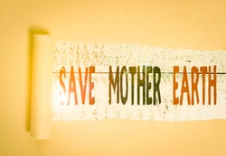 Writing note showing Save Mother Earth. Business photo showcasing doing small actions prevent wasting water heat energy Cardboard which is torn placed above a wooden classic table.