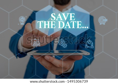 Writing note showing Save The Date. Business photo showcasing Organizing events well make day special event organizers Male wear formal work suit presenting presentation smart device.