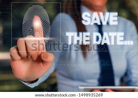 Writing note showing Save The Date. Business photo showcasing Organizing events well make day special event organizers Woman wear formal work suit presenting presentation using smart device.