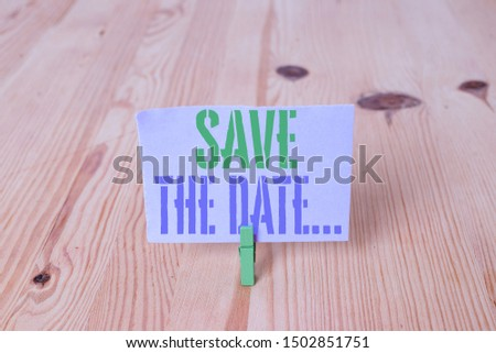 Writing note showing Save The Date. Business photo showcasing Organizing events well make day special event organizers Wooden floor background green clothespin groove slot office.