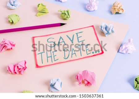 Writing note showing Save The Date. Business photo showcasing Organizing events well make day special event organizers Colored crumpled papers empty reminder blue yellow clothespin.