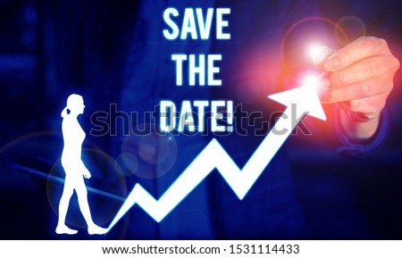 Writing note showing Save The Date. Business photo showcasing Organizing events well make day special event organizers Female human wear formal work suit presenting smart device.