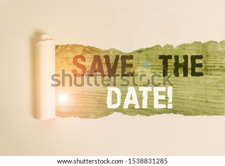 Writing note showing Save The Date. Business photo showcasing Organizing events well make day special event organizers Cardboard which is torn placed above a wooden classic table.