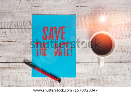 Writing note showing Save The Date. Business photo showcasing Organizing events well make day special event organizers Stationary placed next to a cup of black coffee above the wooden table.