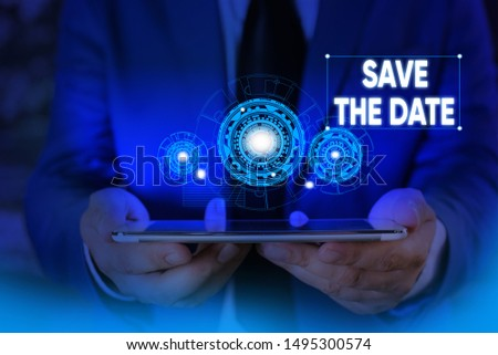 Writing note showing Save The Date question. Business photo showcasing asking someone to remember specific day or time Male wear formal suit presenting presentation smart device.