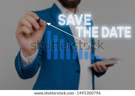 Writing note showing Save The Date question. Business photo showcasing asking someone to remember specific day or time Male wear formal work suit presenting presentation smart device.