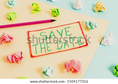 Writing note showing Save The Date question. Business photo showcasing asking someone to remember specific day or time Colored crumpled papers empty reminder blue yellow clothespin.
