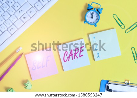 Writing note showing Self Care. Business photo showcasing practice of taking action preserve or improve ones own health Flat lay above copy space on the white crumpled paper.