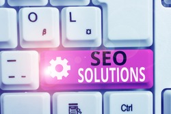 Writing note showing Seo Solutions. Business photo showcasing Search Engine Result Page Increase Visitors by Rankings White pc keyboard with note paper above the white background.
