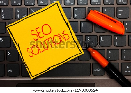 Writing note showing Seo Solutions. Business photo showcasing Search Engine Result Page Increase Visitors by Rankings Yellow paper keyboard Inspiration communicate ideas orange markers.